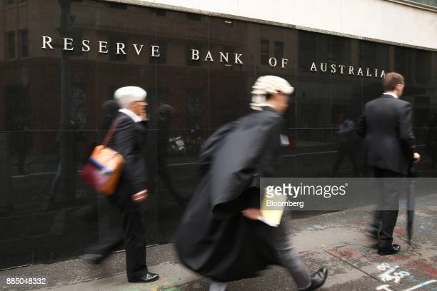Pedestrians walk past the Reserve Bank of Australia headquarters in Sydney Australia on Monday Dec 4 2017 Australia's central bank is on track for...