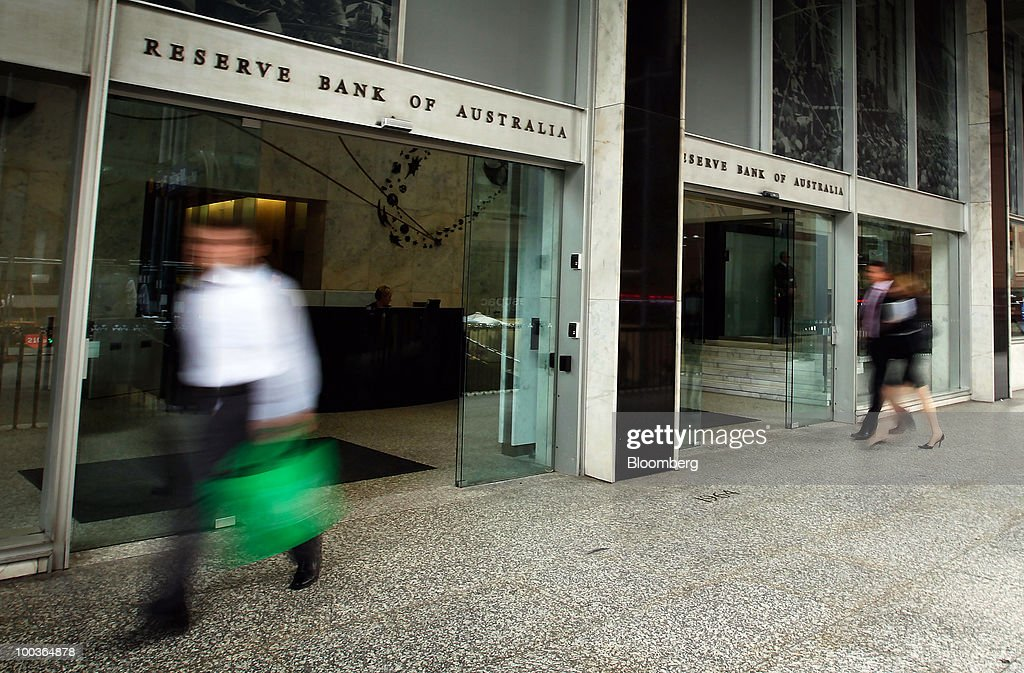 Pedestrians walk past the Reserve Bank of Australia in Sydney, Australia, on Monday, May 24, 2010. The Australian and New Zealand dollars fell against the U.S. currency, extending a three-week decline, on concern Europe's debt crisis will spread. Photographer: Ian Waldie/Bloomberg via Getty Images