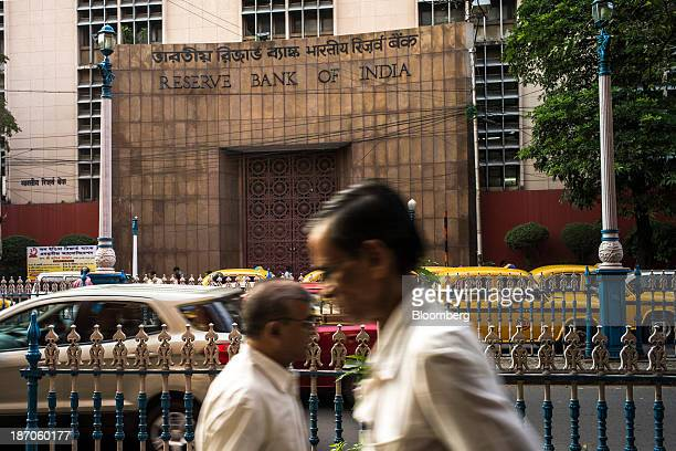Pedestrians walk past the Reserve Bank of India building in the BBD Bagh area of Kolkata West Bengal India on Thursday Oct 31 2013 Indian stocks fell...