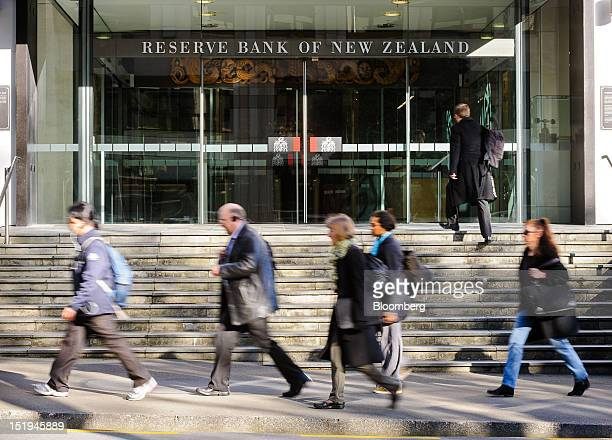 Pedestrians walk past the Reserve Bank of New Zealand headquarters in Wellington New Zealand on Thursday Sept 13 2012 New Zealand signaled an 18month...