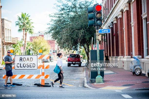 Pedestrians walk past the road closure outside the Contemporary Arts Museum where Serena Williams will be getting married later this evening in New...