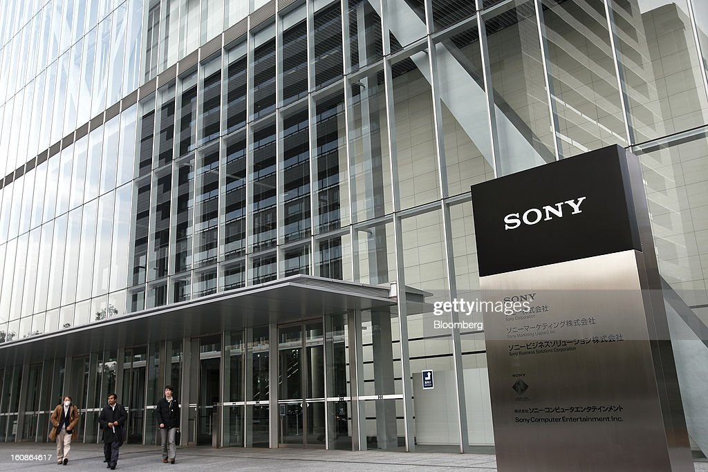 Pedestrians walk past the Sony Corp. headquarters in Tokyo, Japan, on Thursday, Feb. 7, 2013. Sony, Japan's biggest consumer-electronics exporter, reported an eighth consecutive quarterly loss on waning demand for TVs and consumer preferences for devices from Apple Inc. and Samsung Electronics Co. Photographer: Kiyoshi Ota/Bloomberg via Getty Images