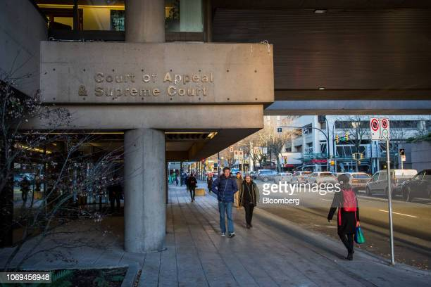 Pedestrians walk past the Supreme Court ahead of a bail hearing for Huawei Technologies Co. Chief Financial Officer Wanzhou Meng in Vancouver,...