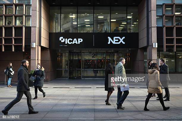 Pedestrians walk past the TP ICAP Plc and NEX Group Plc offices on Broadgate Circle in London UK on Thursday Jan 5 2017 Tullett Prebon Plc completed...
