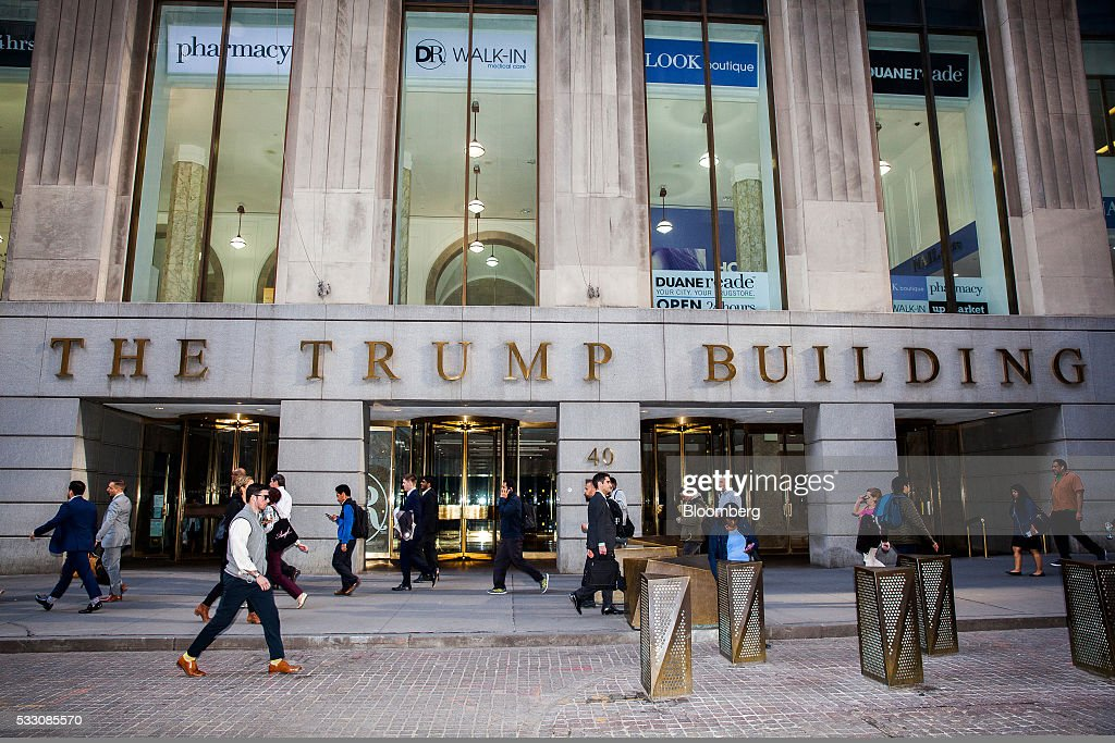 Pedestrians walk past the Trump Building on Wall Street in New York, U.S., on Monday, April 18, 2016. U.S. stocks rose, with the S&P 500 bouncing from a seven-week low, led by a rally in technology shares amid ebbing anxiety over the potential for higher interest rates as early as next month. Photographer: David Williams/Bloomberg via Getty Images