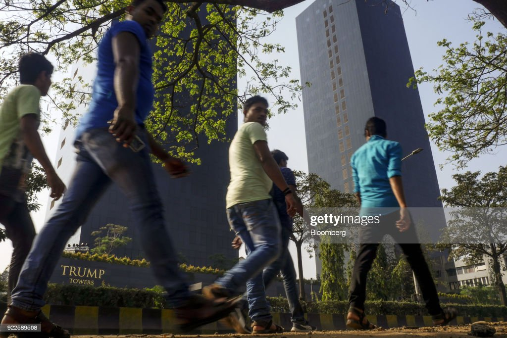 Pedestrians walk past the Trump Towers Pune complex, developed by Panchshil Corp Park Pvt., in Pune, Maharashtra, India, on Wednesday, Feb. 21, 2018. Donald Trump Jr. is slated to speak on foreign policy at an event in New Delhi where Indian Prime MinisterNarendra Modiis also scheduled to speak. Photographer: Dhiraj Singh/Bloomberg via Getty Images