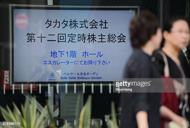 Pedestrians walk past the venue for the Takata Corp annual general meeting in Tokyo Japan on Thursday June 25 2015 Fiat Chrysler Automobiles NV is...