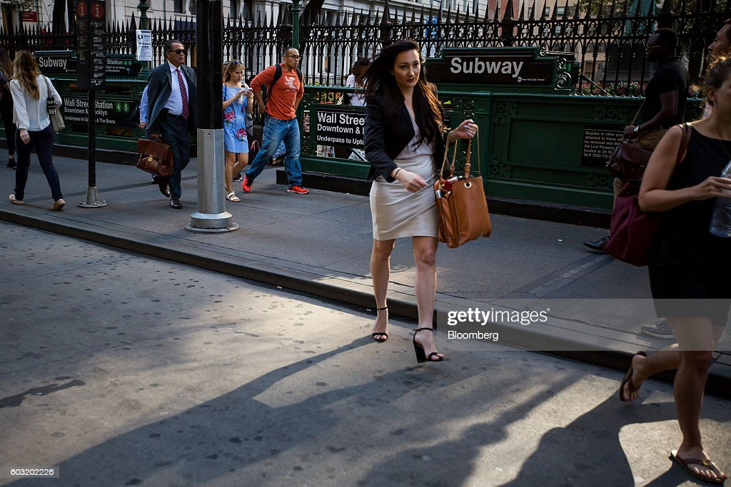 Pedestrians walk past the Wall Street subway station near the New York Stock Exchange (NYSE) in New York, U.S., on Monday, Sept. 12, 2016. U.S. stocks rebounded after the biggest rout since June wiped about $500 billion from the value of equities, while Treasury yields held near two-month highs before the Federal Reserve's Lael Brainard official speaks. Emerging-market assets slumped. Photographer: Michael Nagle/Bloomberg via Getty Images