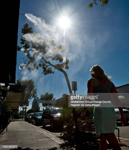Pedestrians walk past the water misters at Gabbi's Mexican Kitchen in Old Towne Orange on Wednesday as temperatures reached the mid90's It should...