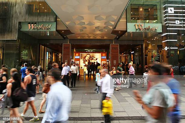 Pedestrians walk past the Westfield Sydney shopping mall operated by Westfield Group in Sydney Australia on Monday Dec 9 2013 Westfield Group's...