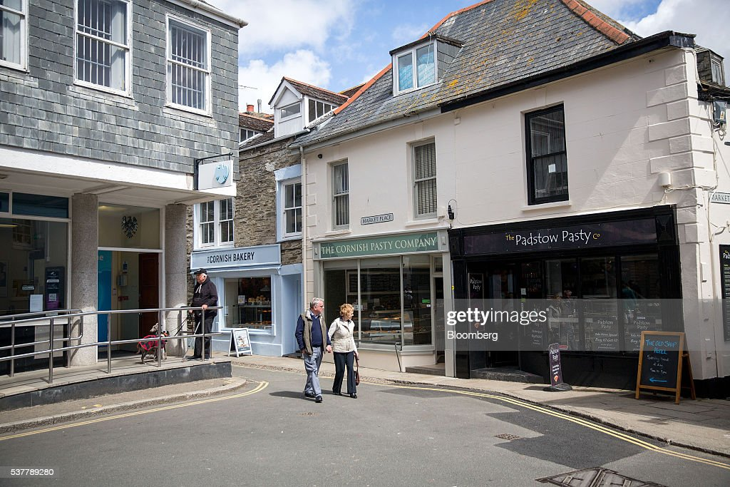 Pedestrians walk past three shops selling Cornish Pasties in Padstow, Cornwall, U.K. on Thursday, April 28, 2016. Cornish Pasties are one of the U.K.'s food products that are protected against imitation throughout the European Union under regulations that recognize regional and traditional foods. Photographer: Simon Dawson/Bloomberg via Getty Images