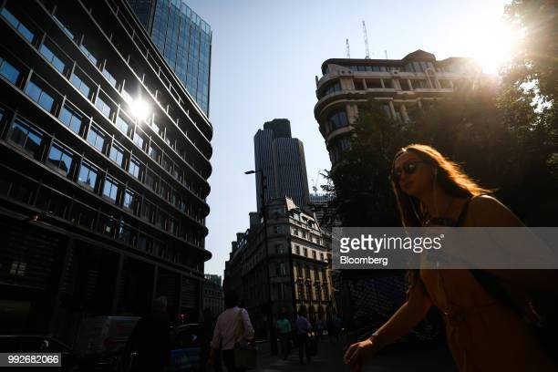 Pedestrians walk past Tower 42 center in London UK on Friday July 6 2018 UK Prime Minister Theresa May is about to unveil in more detail than ever...