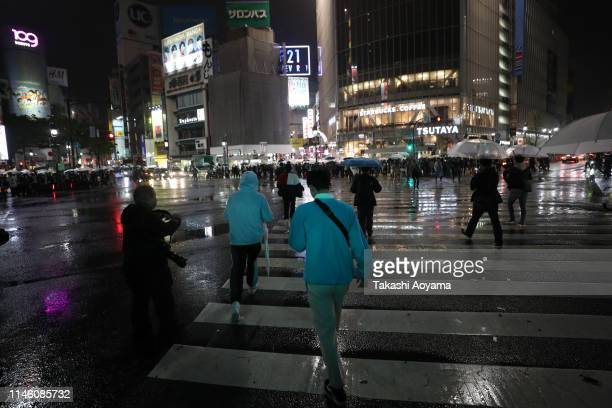 Pedestrians walk the famous Shibuya crossing on May 1 2019 in Tokyo Japan Japan's 85yearold Emperor Akihito became the first Japanese emperor to...