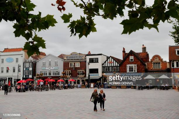 Pedestrians walk through a square with outdoor seating in Salisbury southern England on September 4 2020 A long way from the violent cauldron of...