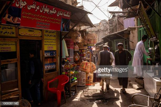 Pedestrians walk through an alley at the Kah Froshi bird market in Kabul Afghanistan on Thursday July 12 2018 US President Donald last year said...