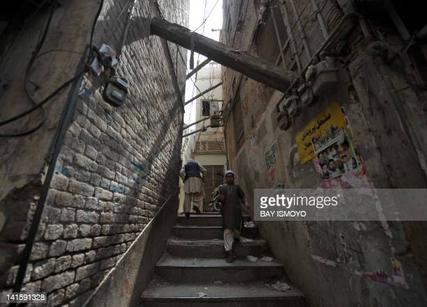 Pedestrians walk through an alley in the old town section of Multan on March 17 2012 Multan one of the oldest cities in the Asian subcontinent and...