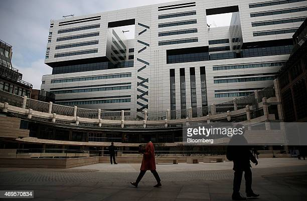 Pedestrians walk through Broadgate Circle as it stands in front of a new office complex No 5 Broadgate to be occupied by UBS AG as construction nears...
