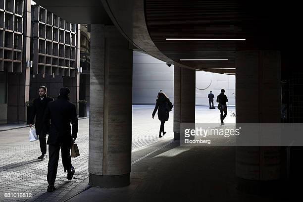 Pedestrians walk through Broadgate Circle in London UK on Thursday Jan 5 2017 Paris could lure as many as 20000 workers from Britain's finance...