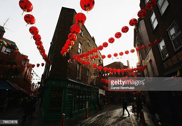 Pedestrians walk through China Town a day before Chinese new years eve on February 5, 2008 in London, England. In Chinese culture, 2008 is the Year...