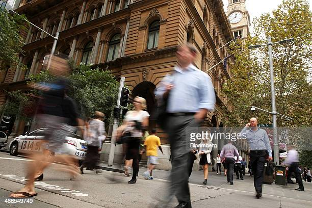 Pedestrians walk through Martin Place in the central business district of Sydney Australia on Monday Feb 10 2014 Australian business confidence rose...
