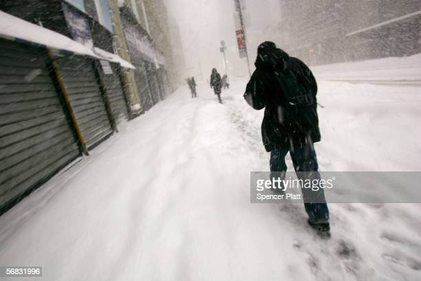 Pedestrians walk through snow in Times Square February 12, 2006 in New York City. A nor?easter that moved up the coast has dropped approximately 22...