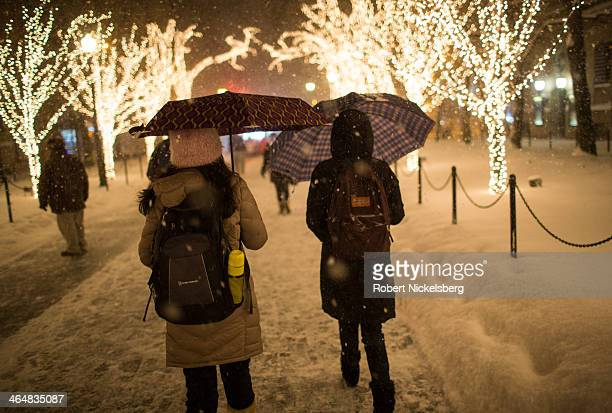 Pedestrians walk through the campus of Columbia University during a snow storm on January 21, 2014 in New York City. The storm ended in the early...