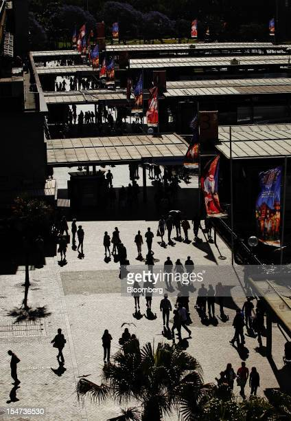 Pedestrians walk through the Circular Quay wharf complex in Sydney Australia on Tuesday Oct 23 2012 Treasurer Wayne Swan on Monday reiterated that...