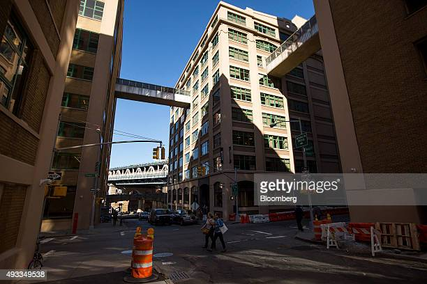 Pedestrians walk through the Dumbo Heights campus in the Brooklyn borough of New York US on Thursday Oct 15 2015 Dumbo Heights a group of industrial...