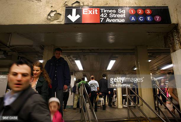 Pedestrians walk through the subway station on the corner of 42nd Street and 7th Avenue in Times Square May 3 2010 in New York City The area resumed...
