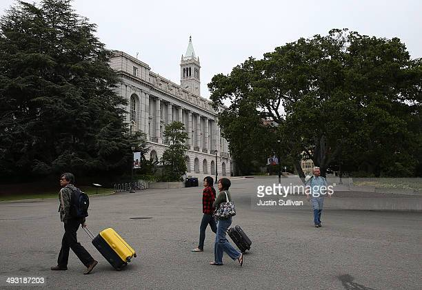 Pedestrians walk through the UC Berkeley campus on May 22 2014 in Berkeley California According to the Academic Ranking of World Universities by...