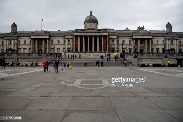 Pedestrians walk through Trafalgar Square as the outbreak of coronavirus intensifies on March 15 2020 in London England President of the United...