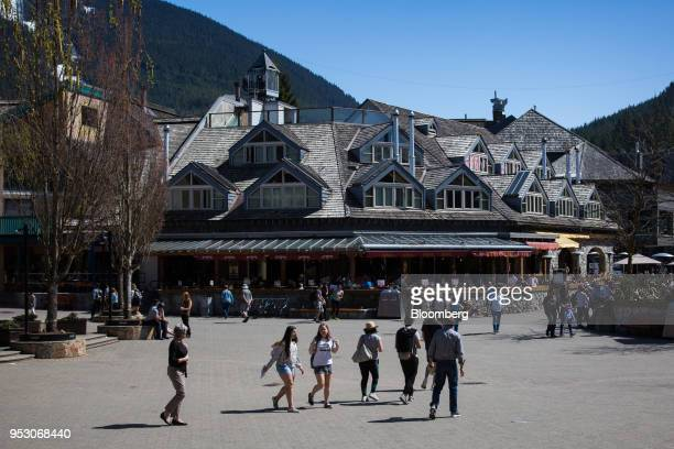 Pedestrians walk through Whistler Village in Whistler British Columbia Canada on Friday April 27 2018 The cost of a typical home in Whistler has more...