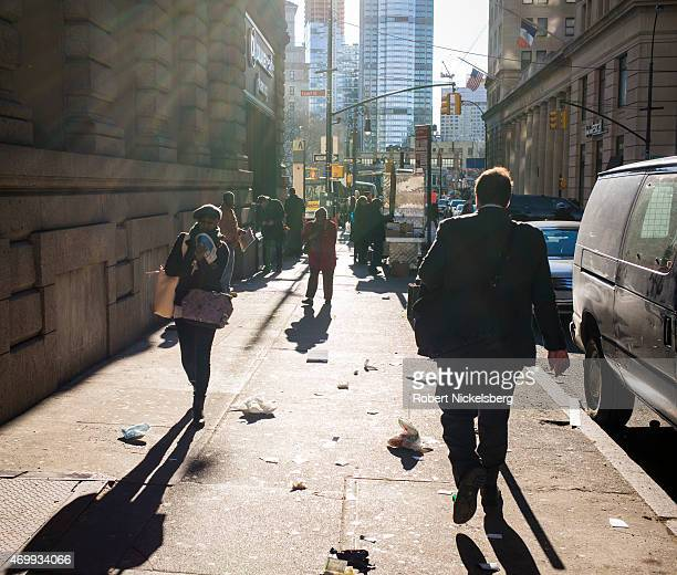 Pedestrians walk toward the Borough Hall subway stop March 31, 2015 in the Brooklyn borough of New York.