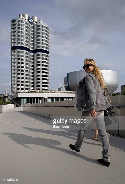 Pedestrians walk towards the Bayerische Motoren Werke AG headquarters in Munich Germany on Friday Sept 3 2010 Bayerische Motoren Werke AG the world's...