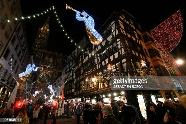Pedestrians walk under Christmasn lights in Strasbourg eastern France on November 23 on the opening day of the city's Christmas market the largest...