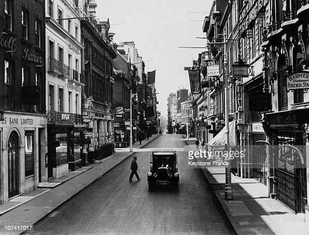 Pedestrians Walking Down The Bond Street In London On 1930
