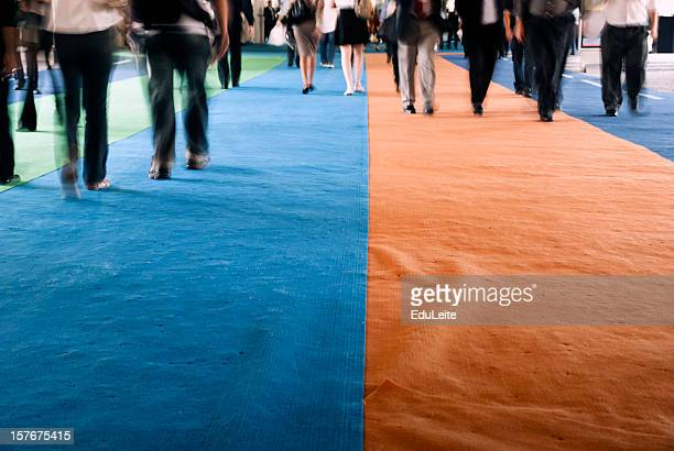 pedestrians walking on a carpet - tradeshow stock pictures, royalty-free photos & images