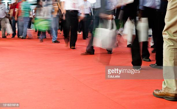 Pedestrians walking on a red carpet