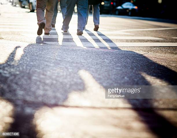 Pedestrians walking on Lower Broadway Street in downtown Nashville