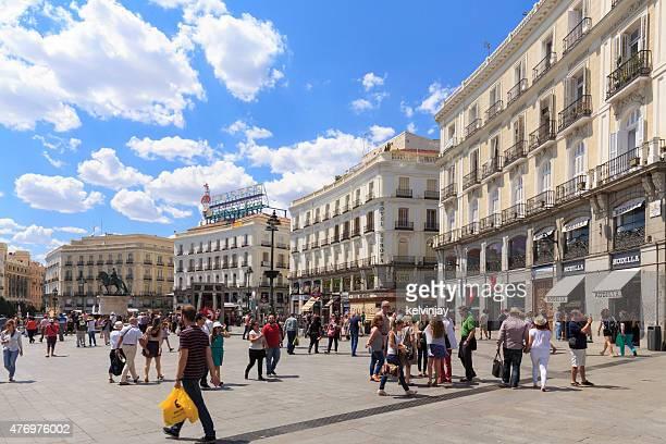 Pedestrians walking through Puerta del Sol in Madrid, Spain