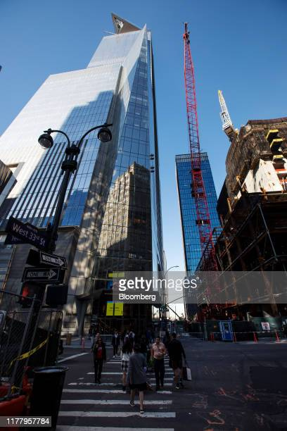 Pedestrians walks below the Edge observation deck at 30 Hudson Yards in New York US on Thursday Oct 24 2019 Edge is scheduled to open to the public...