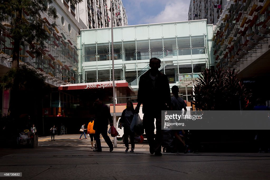 Pedestrians walks outside Lok Fu Plaza, operated by the Link Real Estate Investment Trust (REIT), in Hong Kong, China, on Monday, Nov. 10, 2014. The Link REIT, Asia's largest property trust which owns neighborhood malls, food markets, and car parks, is scheduled to announce interim results on Nov. 13. Photographer: Brent Lewin/Bloomberg via Getty Images