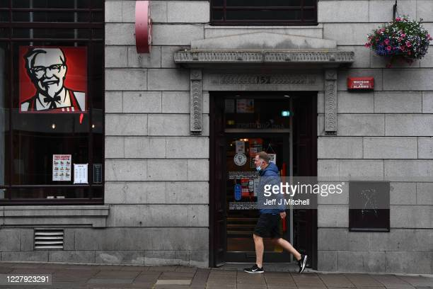 A pedestrians walks past a closed KFC restaurant on August 5 2020 in Aberdeen Scotland Scotland's First Minister Nicola Sturgeon acted swiftly and...