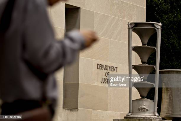 A pedestrians walks past the US Department of Justice headquarters in Washington DC US on Thursday Aug 15 2019 The Justice Department is seeking...