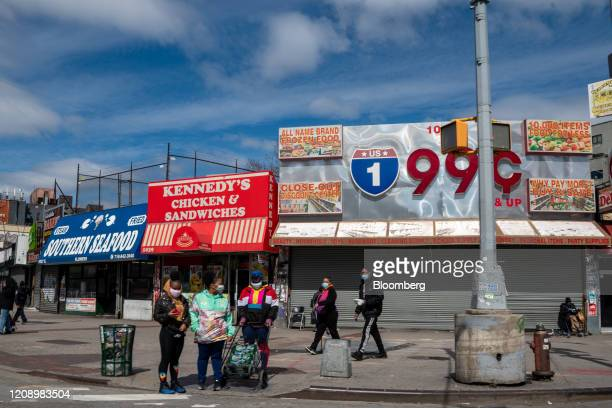 Pedestrians wear protective masks on Southern Boulevard in the Bronx borough of New York, U.S., on Thursday, April 2, 2020. In four months, the new...