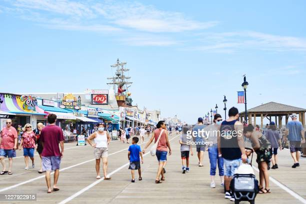 Pedestrians wear protective masks on the boardwalk in Ocean City, New Jersey, U.S., on Saturday, Aug. 1, 2020. From California's wine country to...