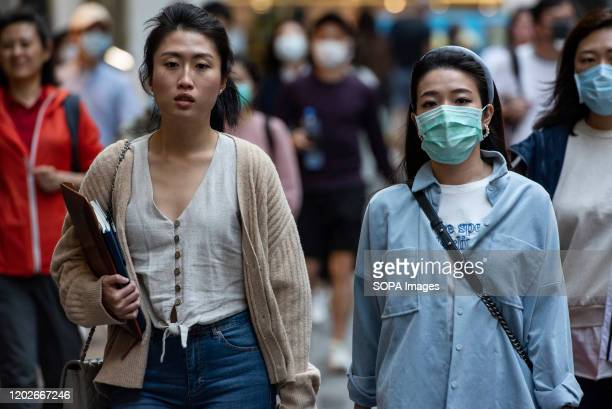 Pedestrians wearing face masks as a preventive measure against the Coronavirus official name covid19 seen in Central district in Hong Kong