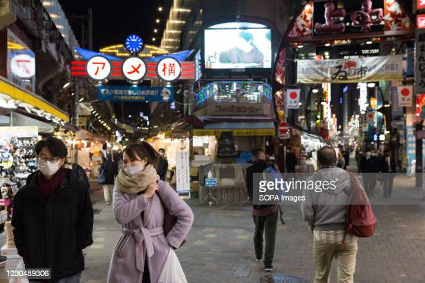 Pedestrians wearing face masks walk along the Ame Yoko street. 2392 new Coronavirus cases were reported on January 8th 2021, the first day of the...