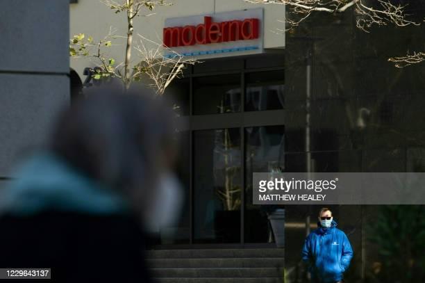 Pedestrians wearing face masks walk past the headquarters of biotechnology company Moderna in Cambridge, Massachusetts on November 16, 2020. - US...