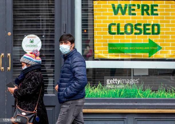 Pedestrians wearing PPE , of a face mask or covering as a precautionary measure against spreading COVID-19, in Dublin on October 19 amid reports that...
